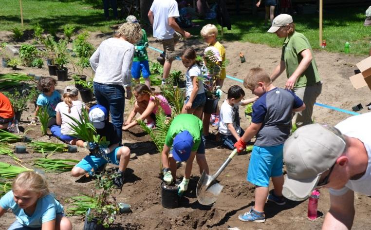Volunteers taking part in community rain garden planting.